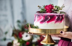 cake-decorated-by-red-berries-and-macaron